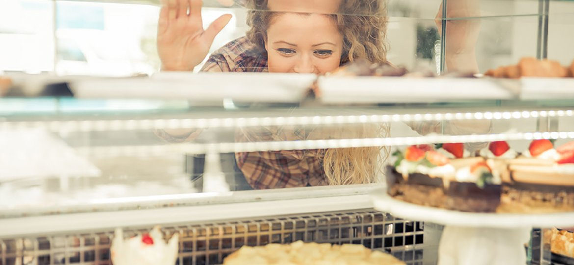 Woman choosing pastries in a store